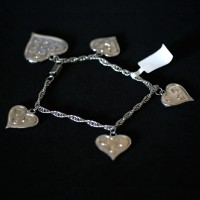 Steel Bracelet Twisted Heart a great job and 4 Small Hearts