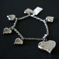 Steel Bracelet Twisted Heart a great job and 5 Small Hearts